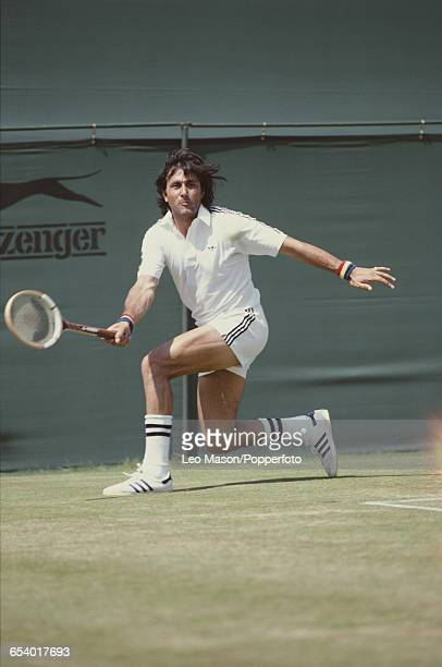 Romanian tennis player Ilie Nastase pictured in action competing to be knocked out in the first round of the Men's Singles tournament at the...