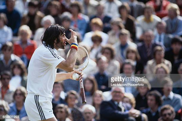 Romanian tennis player Ilie Nastase pictured in action during competition to reach the quarterfinals of the Men's Singles tournament at the Wimbledon...