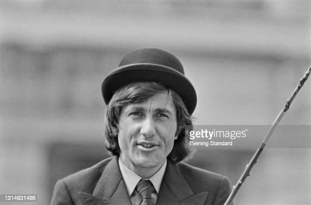 Romanian tennis player Ilie Nastase wearing a bowler hat, UK, 29th May 1974.