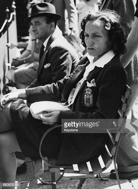 Romanian tennis player Magda Rurac sitting on a bench as she watched her husband Vini Rurac in action against I Toczynski at Wimbledon Tennis...