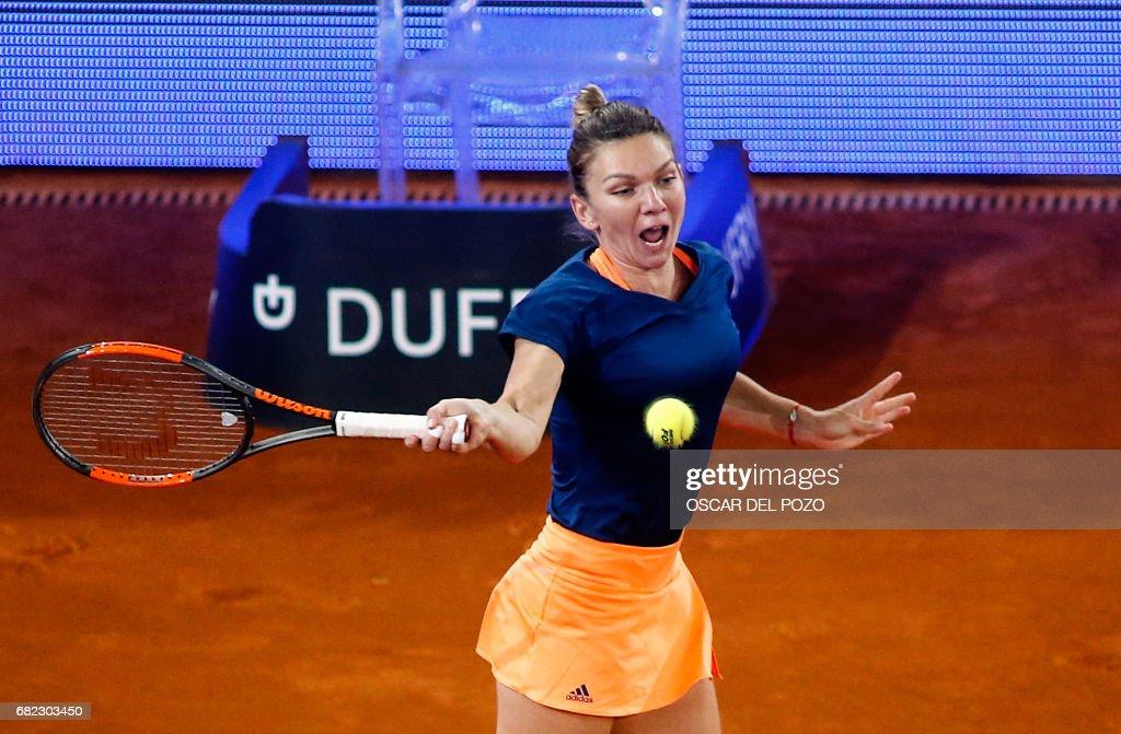 Romanian tennis player Simona Halep returns the ball to Latvian tennis player Anastasija Sevastova during the WTA Madrid Open semi final match in Madrid, on May 12, 2017. Halep won 6-2 and 6-3. /