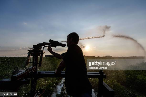 Romanian worker adjusts an irrigation plant at a potato field on August 6 2018 in Eschollbruecken near Darmstadt Germany Farmers are fighting against...