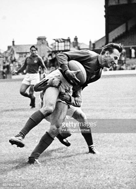 Romanian XV's R Veluda is tackled by Harlequins' DA Barker