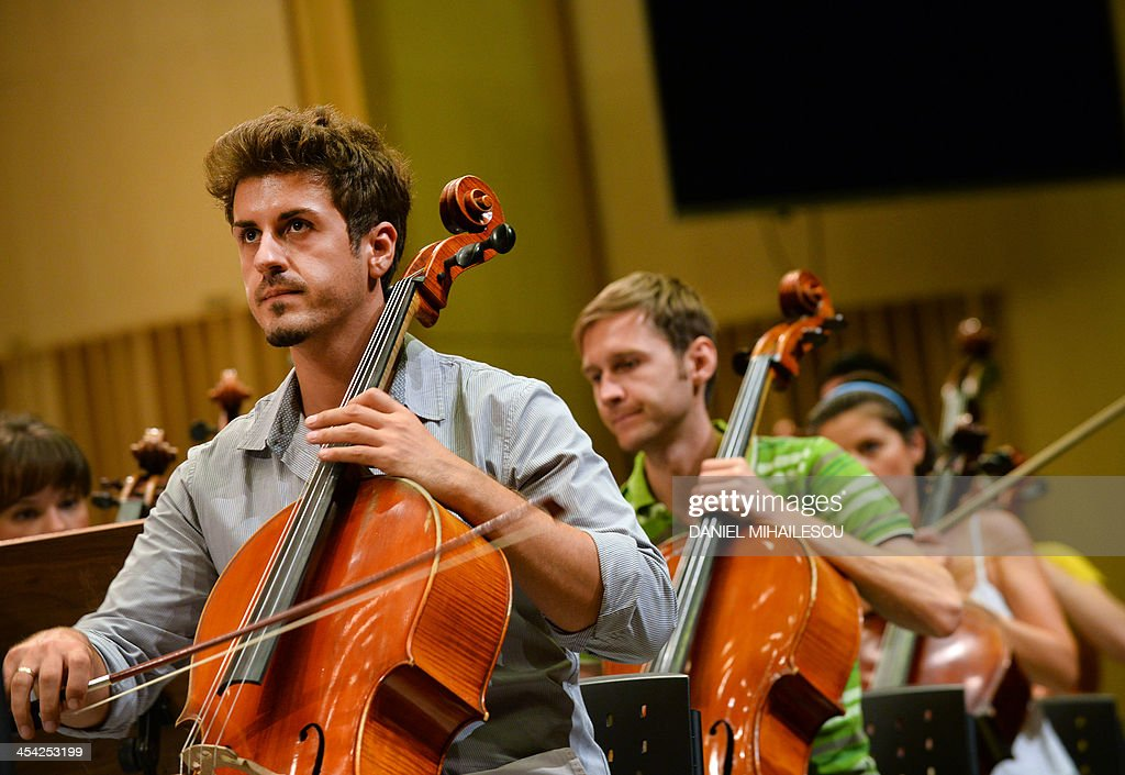 Romanian Youth Orchestra attend a rehearsal for the George Enescu classical music festival on September 8, 2013 in Bucharest
