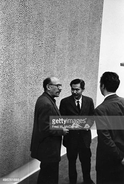 Romanianborn American artist Saul Steinberg speaks with unidentified others New York New York September 27 1960