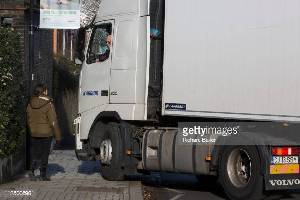 A Romanianregistered HGV lorry attempts to make a turn from Ferndene Road onto Herne Hill SE24 on 10th February 2019 in London England Large lorries...