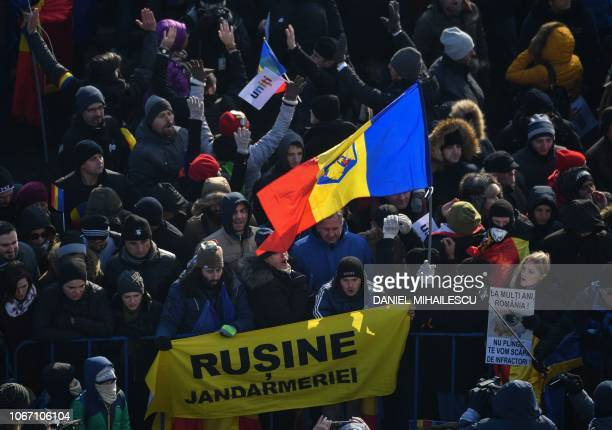 Romanians boo the gendarmes as they hold a banner reading Shame to the gendarmes referring to the violences occured during the August 10 2018...