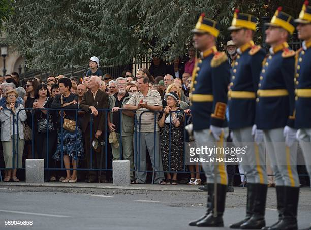 Romanians look on the funeral ceremony of the late Queen Anne of Romania at the Royal Palace now The Art Museum of Romania as members of the Royal...