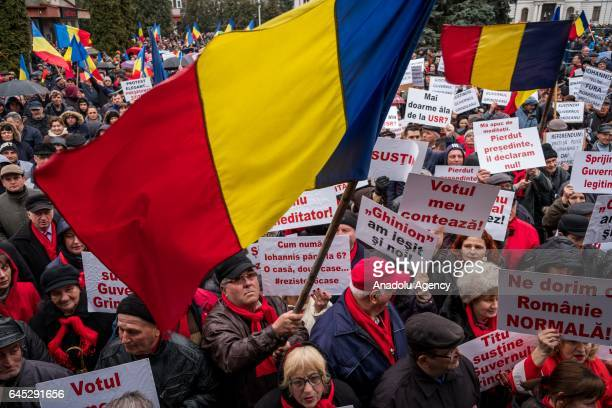 Romanians take part in a progovernment rally in the town of Targoviste Romania on February 25 2017 Progovernment rally held following recent massive...