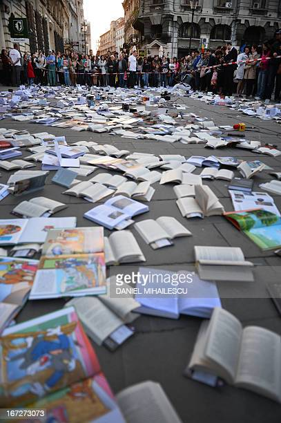 Romanians wait for free books offered by a publishing house and displayed on the pavement on The World Book Day in Bucharest on April 23 2013 AFP...