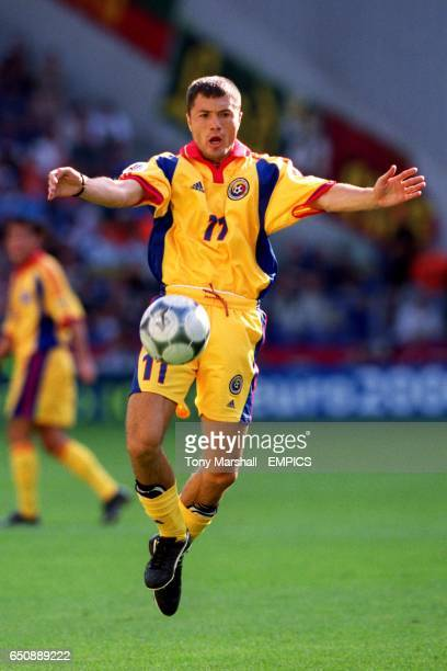 Romania's Adrian Ilie chests the ball down