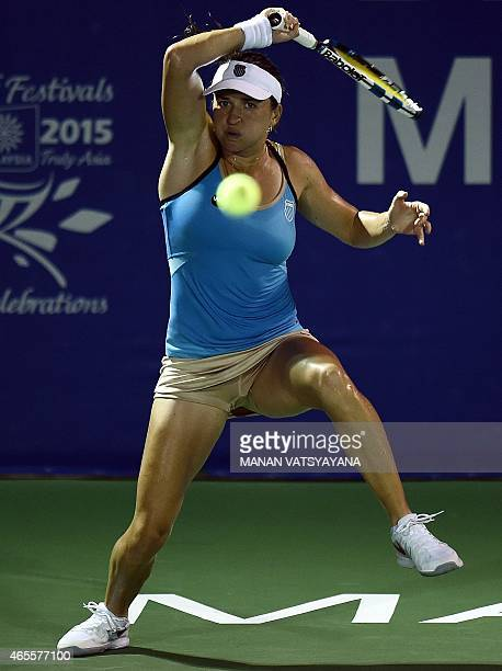 Romania's Alexandra Dulgheru returns a shot against Caroline Wozniacki of Denmark during their women's singles final match of the 2015 BMW Malaysia...