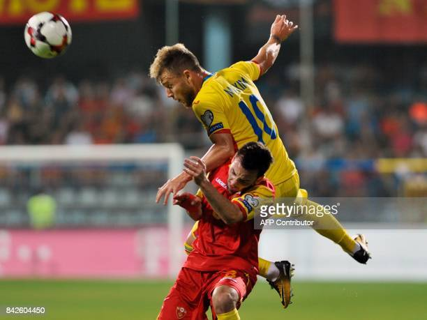 Romania's Alexandru Maxim vies with Montenegro's Marko Jankovic during the FIFA 2018 World Cup football qualifier match between Montenegro and...