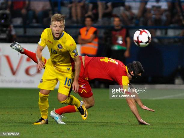 Romania's Alexandru Maxim vies with Montenegro's Nikola Vukcevic during the FIFA 2018 World Cup football qualifier match between Montenegro and...