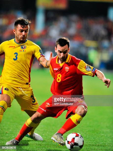 Romania's Alin Tosca vies with Montenegro's Marko Jankovic during the FIFA 2018 World Cup football qualifier match between Montenegro and Romania in...