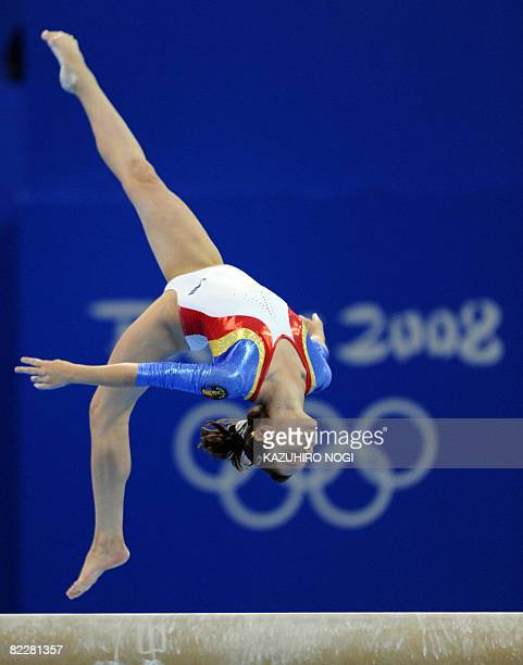 Romania's Anamaria Tamirjan competes on the floor during the women's team final of the artistic gymnastics event of the Beijing 2008 Olympic Games in...