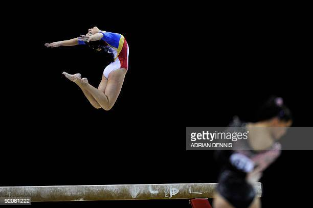 Romania's Anamaria Tamirjan performs in the balance beam event in the women's individual allaround final during the Artistic Gymnastics World...