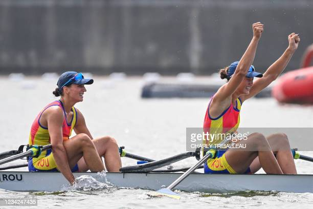 Romania's Ancuta Bodnar and Simona Radis celebrate after finishing first to win gold in the women's double sculls final during the Tokyo 2020 Olympic...