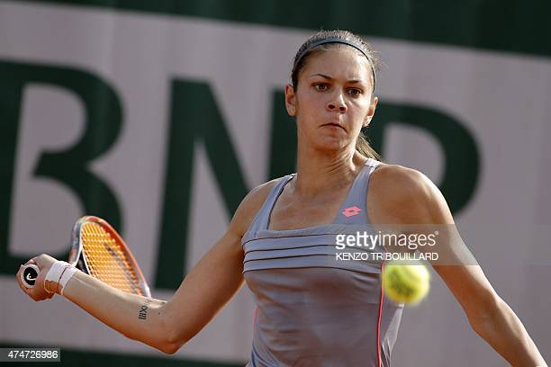 Romania's Andreea Mitu returns the ball to France's Alize Lim during the women's first round of the Roland Garros 2015 French Tennis Open in Paris on...