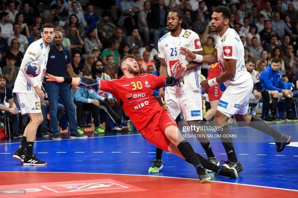 Romania S Bogdan Rata Shoots The Ball During The Handball