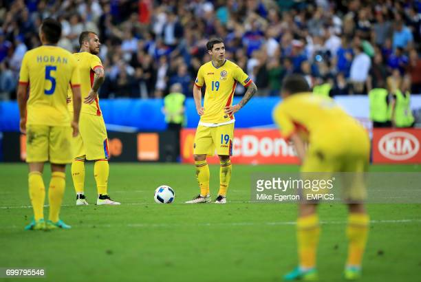 Romania's Bogdan Stancu and Romania's Denis Alibec appear dejected after France's Dimitri Payet scored his side's second goal of the game