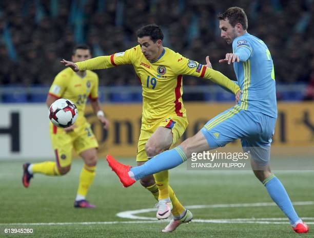 Romania's Bogdan Stancu vies with Kazakhstan's Sergei Maliy during the WC 2018 football qualification match between Kazakhstan and Romania in Astana...