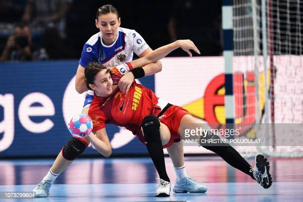 Romania's centre back Eliza Buceschi vies for the ball with Russia's line player Mayya Petrova during the EHF EURO 2018 European Women's Handball...