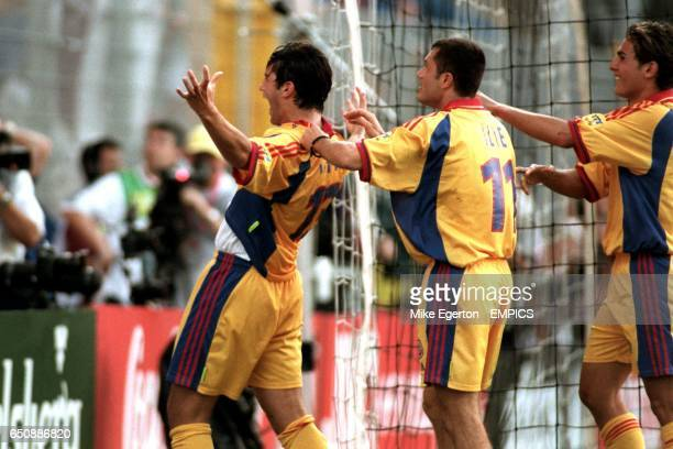 Romania's Cristian Chivu celebrates scoring the opening goal with teammate Adrian Ilie