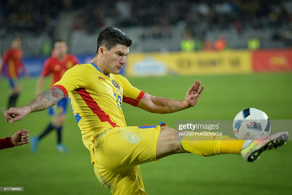 Romania's Cristian Ionut Sapunaru clears the ball during the friendly football match between Romania and Spain in Cluj Napoca, Romania on March 27, 2016. / AFP / ANDREI
