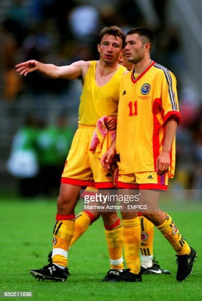 Romania's Dan Patrescu with goalscorer Adrian Ilie after the match