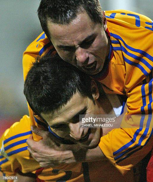Romania's Daniel Niculae and Floretin Petre celebrate after Niculae scored 4-0 against Albania during their Euro 2008 Group G qualifying football...
