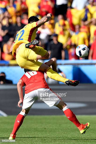 Romania's defender Cristian Sapunaru clashes with Switzerland's forward Admir Mehmedi during the Euro 2016 group A football match between Romania and...
