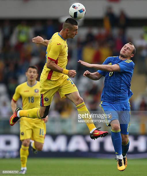 Romania's defender Dragos Grigore fights for the ball with Ukraine's forward Roman Zozulya during the international friendly football match between...