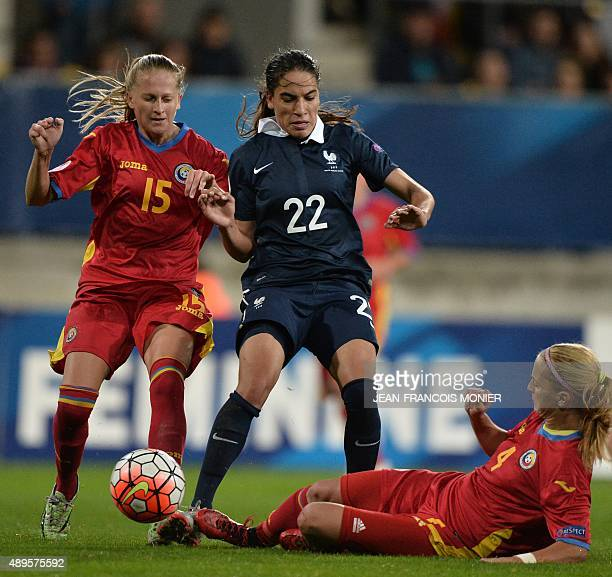 Romania's defender Olivia Oprea vies for the ball with France's defender Amel Majri and Romania's midfielder Ioana Bortan during the Women's Euro...