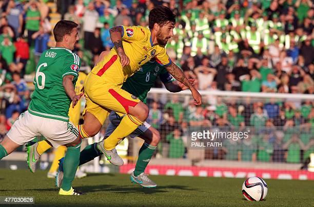 Romania's defender Paul Papp vies with Northern Ireland's defender Chris Baird and Northern Ireland's midfielder Steven Davis during the Euro 2016...