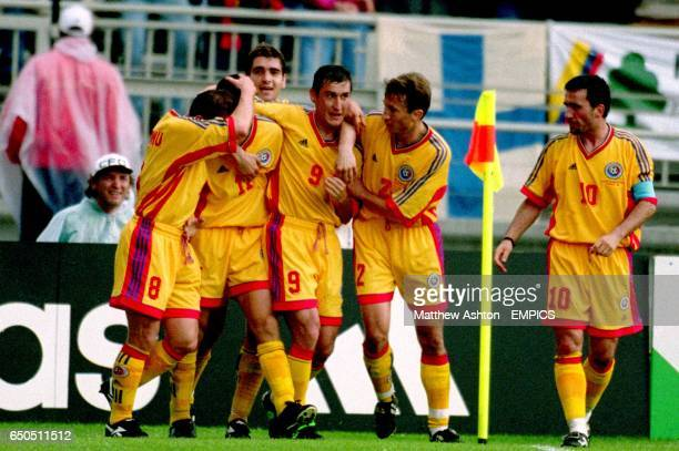 Romania's Dorinel Munteanu Adrian Ilie Ilie Dumitrescu Viorel Moldovan Dan Petrescu and Georghe Hagi celebrate after Adrian Ilie's goal put Romania...