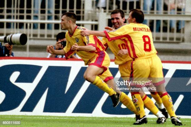 Romania's Dorinel Munteanu and Georghe Hagi celebrate with Adrian Ilie after his goal put Romania 10 up against Colombia