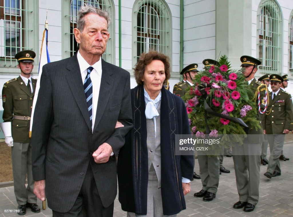 Romania's former King Michael and his wife Anne de Bourbon-Parme, surrounded by Czech soldiers holding wreath, 05 May 2005 in Kromeriz, pay homage to Romanian soldiers who died in World War II. King Michael began 03 May a five-day trip through Slovakia and the Czech Republic to visit the graves of Romanian soldiers. The 83-year-old Michael, who switched sides during the war and was the last surviving head of state to have played a mayor role in the conflict, is doing the driving himself and is accompanied by his wife Anne de Bourbon-Parme and son Prince Radu. Michael already visited Bratislava and Banska Bystrica in Slovakia and Kromeriz in the Czech Republic and will visit Brno and Prague before flying to Moscow at the invitation of Russian President Vladimir Putin to take part 60th anniversary celebrations of the end of WWII.