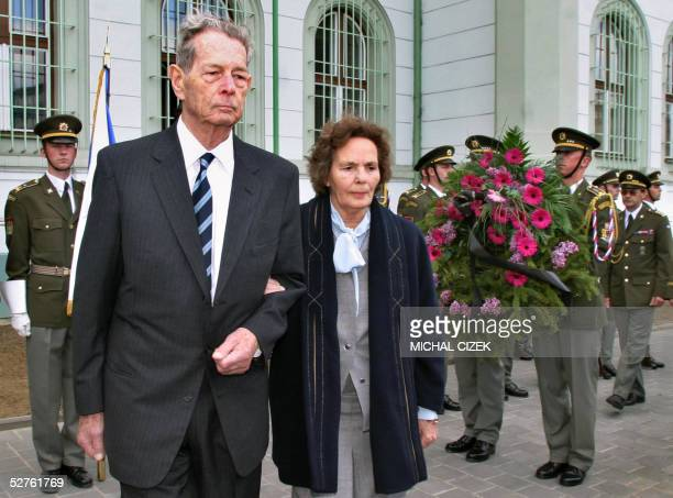 Romania's former King Michael and his wife Anne de BourbonParme surrounded by Czech soldiers holding wreath 05 May 2005 in Kromeriz pay homage to...
