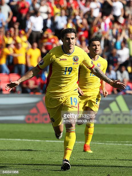 Romania's forward Bogdan Stancu celebrates after scoring a penalty during the Euro 2016 group A football match between Romania and Switzerland at the...