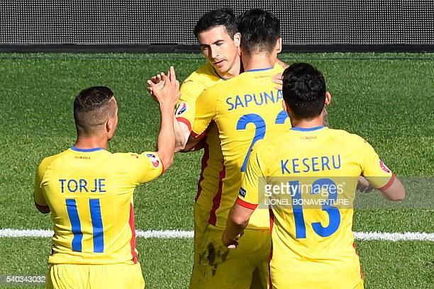 Romania's forward Bogdan Stancu celebrates with team mates after scoring a penalty during the Euro 2016 group A football match between Romania and...