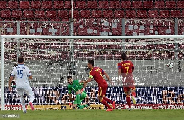 Romania's forward Ciprian Marica scores a penalty kick during the qualifying football match for the 2016 European Championship Greece vs Romania at...
