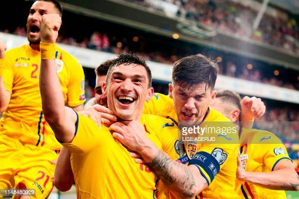 Romania's forward Claudiu Keseru celebrates scoring with his teammates during the UEFA Euro 2020 qualifier Group F football match Norway against...