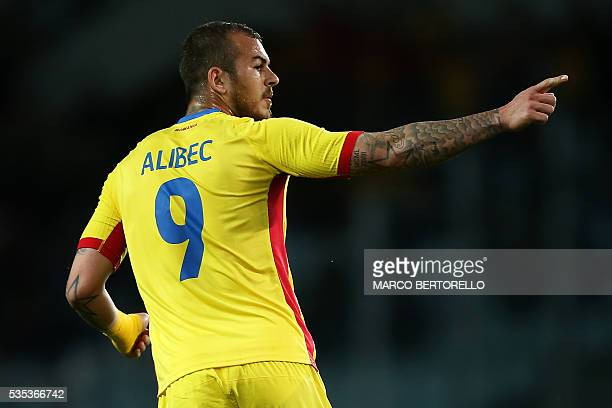 Romania's forward Denis Alibec celebrates after scoring during the international friendly football match between Romania and Ukraine at 'Grande...