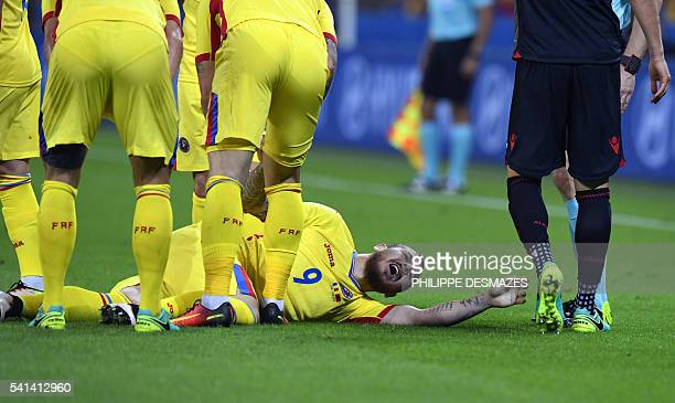 Romania's forward Denis Alibec reacts as he lies on the pitch during the Euro 2016 group A football match between Romania and Albania at the Parc...