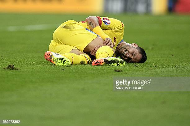 Romania's forward Florin Andone grimaces on the pitch during the Euro 2016 group A football match between France and Romania at Stade de France in...