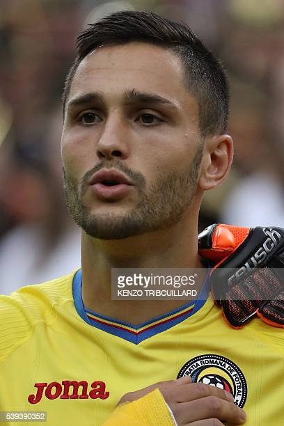 Romania's forward Florin Andone looks on before the start of the Euro 2016 group A football match between France and Romania at Stade de France in...
