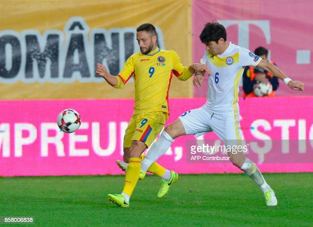 Romania's forward Florin Andone outruns Kazakhstan's defender Yeldos Akhmetov during the FIFA 2018 World Cup qualifying football between Romania and...