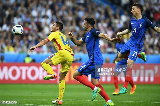 Romania's forward Florin Andone vies for the ball with France's defender Adil Rami and France's defender Laurent Koscielny during the Euro 2016 group...