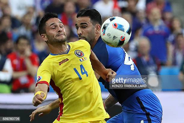 Romania's forward Florin Andone vies for the ball with France's defender Adil Rami during the Euro 2016 group A football match between France and...